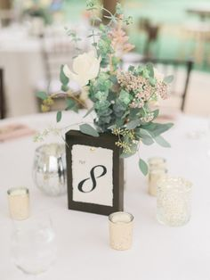 simple chic green wedding centerpiece; photo: Honey Honey Photography