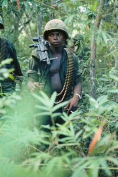 Soldier who might be a guerrilla is on patrol and on the lookout for booby traps.