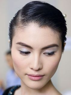 Chanel - sleek updo and pearly white eyeshadow | http://www.shopprice.ca