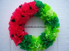 Watermelon Outdoor Wreath...  Dollar store plastic tablecloths pinked into squares and bunched along wreath form. Summer July door easy cheap weather proof