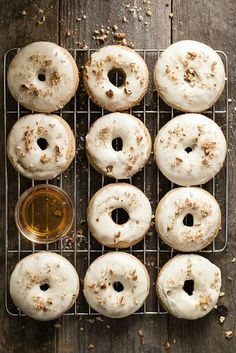 Easy baked donuts with a sweet maple syrup and pecan frosting. No mess, no fuss with baked donuts!!