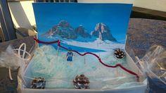 Ein Ski Gutschein winterlich verpackt