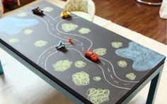 We've showed you similar ideas to this one before, but it had never occurred to me that you could use a chalk board table to make race tracks or towns to drive cars on. Add some lego buildings and the whole thing becomes three dimensional. on The Owner-Builder Network  http://theownerbuildernetwork.com.au/wp-content/blogs.dir/1/files/ideas-for-kids-1/chalk-board.jpg