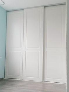 Schuifdeurfront van paneeldeuren met binnenvak voor bestaand interieur