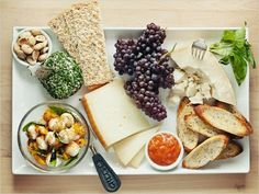 cheese platter.  Crackers, grapes, marinated mushrooms, nuts, baguette, jam, bree & goat cheese.