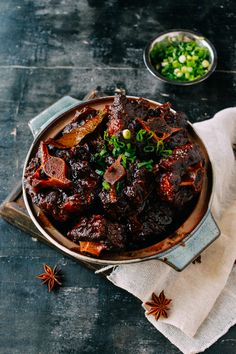 Chinese braised oxtails cooked the authentic method and braised with soy sauce and spices until they're tender and extremely flavorful.