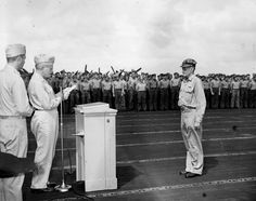 US Navy Admiral William Halsey presenting Vice-Admiral John McCain with the Navy Cross on the flight deck of USS Hancock at anchor in the Ulithi Lagoon, Caroline Islands, 30 Nov 1944. (National Museum of Naval Aviation)