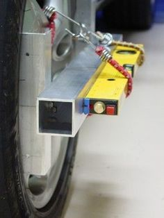 Toe-In Measurement Fixture by dr bob -- Homemade toe-in measurement fixture intended to facilitate the process of DIY automotive alignment. Fashioned from aluminum angle and square tubing, and utilizing an off-the-shelf laser level. Assembly is mounted to the wheel via bungee cords. http://www.homemadetools.net/homemade-toe-in-measurement-fixture-2
