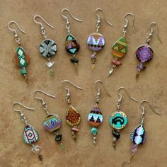 hand paint little polymer clay disc beads with cool native american designs