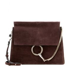 Chloé - Faye suede shoulder bag - Chloé's 'Faye' bag is timeless and elegant. Crafted from soft, supple suede, it features a tonal flap to the front and is accented with a gold and silver-tone loop and chain details. Go hands-free by wearing it cross-body, keeping all your essentials organised in the separate internal compartments. seen @ www.mytheresa.com