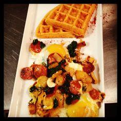 Smoked paprika savory waffle, sautéed spinach chorizo and eggs