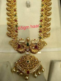 Stunning gold long necklace with dancing peacock desig. Necklace having mango hangings. Mango s with peacock design. Necklace studded with precious stones. Gold Temple Jewellery, Moon Jewelry, Gold Jewellery Design, India Jewelry, Gold Jewelry Simple, Simple Necklace, Mango Mala, Rose Gold Earrings, Bridal Jewelry