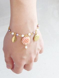 Charm Bracelet Pink Rose with Floral Gold locket. $24.00.https://www.etsy.com/listing/40818505/charm-bracelet-pink-rose-with-floral