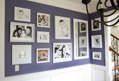 I like the moulding + dark wall + white frames