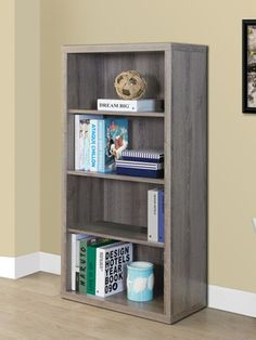 A beautiful choice for your home or office, this bookcase boasts a soft  taupe finish that lends the look