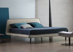 Bonaldo Joe Bed - from the creative eye of Mauro Lipparni.    A perfectly calibrated curve connecting the tapered profile of the headboard to the horizontal element of the base.  From £1,720