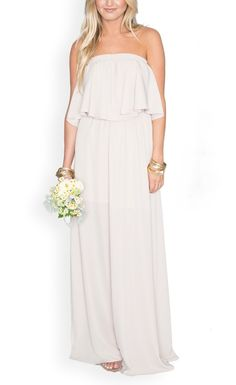 The bridesmaids will look stunning in this elegant gown. A ruffled bodice adds a flowy touch to a boho-chic wedding.
