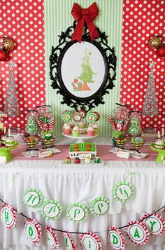 red and green grinch themed christmas dessert table