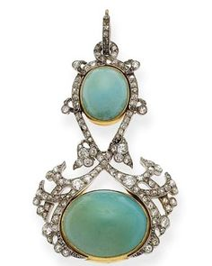A belle époque turquoise and diamond pendant. . Composed of two articulated plaques, each set with cabochon turquoise, surrounded by old-cut diamonds, mounted in platinum and gold, circa 1905.