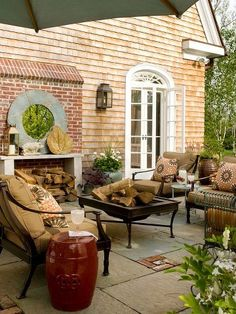 Hip hip hooray, it's Saturday! 'Like' this post if you'd like to host a campfire get-together on this cozy fall patio tonight.    See more outdoor living spaces: http://bhgmag.co/UovHgq