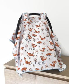 **SAME DAY SHIPPING**  This car seat canopy features a cute woodland/tribal fox pattern. Background color is white. Perfect for your woodland or fox