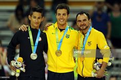 July 12 - Roller Sports - Figure Skating - Men's Free Program.  Gold winner Marcel Sturmer of Brazil (C), silver winner John Burfield of the USA, bronze win ner Diego Duque (R) of Colombia celebrate their medals in the Roller Sport-Figure Skating Final Men competition at the 2015 Pan American Games in Toronto, Canada, on July 12, 2015. AFP PHOTO/HECTOR RETAMAL
