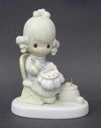 Precious Moments figurine This is the first one I got. A Mother's Day gift, when the girls were very young. But mine is a music box. I love it.