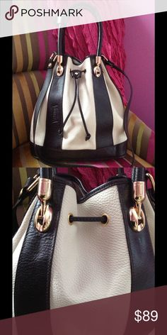 """Italian-made Leather Bucket Bag NWT Beautiful Valentina leather bucket bag in pebbled black and cream. Shoulder strap in addition to handles with 5.5"""" drop. Gold hardware, including bottom feet. Leather strap to pull bag shut tight. Fully lined beige fabric. Inside zip pocket, 2 slots. Purchased at TJMaxx. PRICE FIRM. NO BUNDLE DISCOUNT Valentina Bags"""