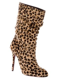 Beige/brown pony fur boots from Cesare Paciotti featuring a leopard print, a pointed toe, a stiletto heel and a pull-on design.