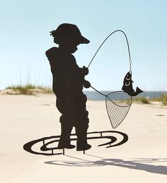 Our exclusive Boy Fishing Garden Stake captures a timeless image of a wee fisherman reeling in his catch of the day! Metal with a black matte finish, the laser-cut, silhouette design of our garden art is a dramatic contrast against any lawn, hedge or flowerbed.