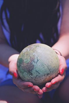 world. world in your hands. holding the world.