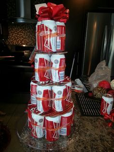 Me trying to make a beer cake.. I used the beer cardboard box to seperate the beer and a hard plastic plate for the bottom one.