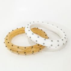 A personal favorite from my Etsy shop https://www.etsy.com/listing/234969331/pair-2-vintage-lucite-bangles-white