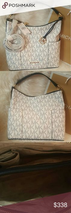 NWT* Michael Kors Anita Large Conv. Shoulder Bag* NWT* Michael Kors Anita Large Conv. Shoulder Bag w/strap * Colors: Navy & White* Gorgeous Bag * Feel free to Inquire and ask Questions * Reasonable offers accepted * Bundle & Save * You never know if you don't offer* Michael Kors Bags