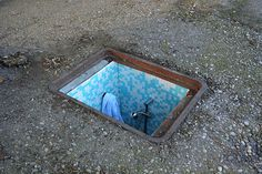 """Abandoned manhole covers in Milan, turned into miniature rooms by installation artist Biancoshock. Of his work he says """"Intervention that, parodically, speaks about people forced to live in extreme. Cool Secret Rooms, Metalarte, Hanging Artwork, Artistic Installation, Colossal Art, Miniature Rooms, Italian Artist, Street Artists, Oeuvre D'art"""