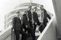 The Beach Boys with the Capitol Records building in the background.