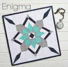 "Enigma is a stunning paper pieced mini quilt, and it's my interpretation of the ""Bachelor's Puzzle"" block. It is paper pieced in. Star Quilts, Mini Quilts, Quilt Blocks, Baby Quilts, Quilting Projects, Quilting Designs, Quilting Ideas, Modern Quilting, Sewing Projects"