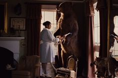 Minnie vacuuming the bear in The Help