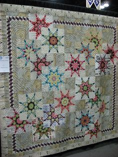 unique circle quilts | Unique feathered stars setting. Not a fan of the circle quilting, but ...