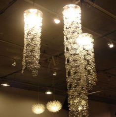 Eco-Friendly Blossoms By Michelle Brand    the bottoms of discarded plastic soda bottles to create these breathtakingly beautiful decorative light fixtures, lamp shades, curtains, room dividers, and more.  Ingenious and quite stunning,