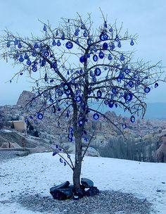 Evil eye tree in Cappadocia, Turkey. Evil eye charms are common to Middle Eastern and Mediterranean cultures. Can be worn as jewelry, hung as trinkets around the home, and so forth. Istanbul, Turkish Eye, Evil Eye Pendant, Evil Eye Jewelry, Adventure Is Out There, Art Plastique, Yard Art, Decoration, Greece