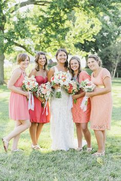 Pink and coral bridesmaid dresses {Photo by Krista A. Jones Photography via Project Wedding}