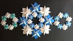 Origami Wreath, Origami Ornaments, Paper Crafts Origami, Origami Stars, Origami Flowers Tutorial, Flower Tutorial, Snowflake Wreath, Snowflakes, Diy And Crafts