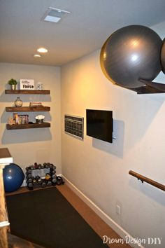 Workout Ball Holder - Home Gym Organization - Dream Design DIY - Tap the pin if you love super heroes too! Cause guess what? you will LOVE these super hero fitness shirts! Diy Home Gym, Gym Room At Home, Home Gym Decor, Best Home Gym, Workout Room Home, Workout Rooms, Exercise Rooms, Workout Room Decor, House Workout