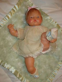 Vintage Thumbellina doll. I had one of these. They writhed around like a real baby when you pulled a string on the doll's back.