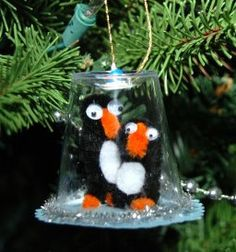Playful Penguin Snow Globe Ornaments are easy homemade Christmas ornaments that will fill you with joy.