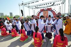 Girls from Taiyuan receive a hairpin to symbolize their place as a woman. This traditional Chinese coming of age ceremony was sponsored by CYRTV and occurred during the 2nd Shanxi Radio and TV Carnival.