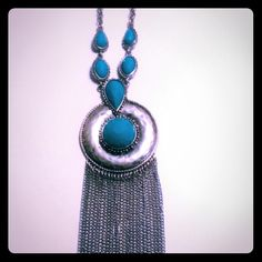Long silver necklace with turquoise Long silver necklace with turquoise accents. Super cute and on trend! Jewelry Necklaces