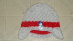 adult earflap hat. red band has a snowman sewn on