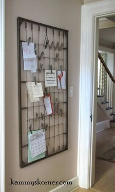 What a great idea, using an old crib spring to clip pictures, notes, and cards to!